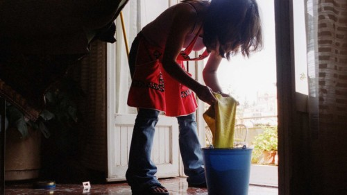 A 25-year-old woman working without a permit as a COLF - Italian for house maid - is seen performing her daily chores in a home in Rome, Tuesday Aug. 27, 2002. Starting Wednesday Aug. 28, the Italian government will make available in post offices, forms for illegal immigrants working in Italy to ask for regularization. (AP Photo/Alessandra Tarantino)