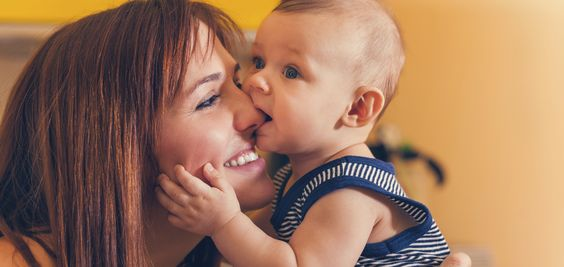 Happy Mother With Adorable Baby Boy In Intimate Embrace